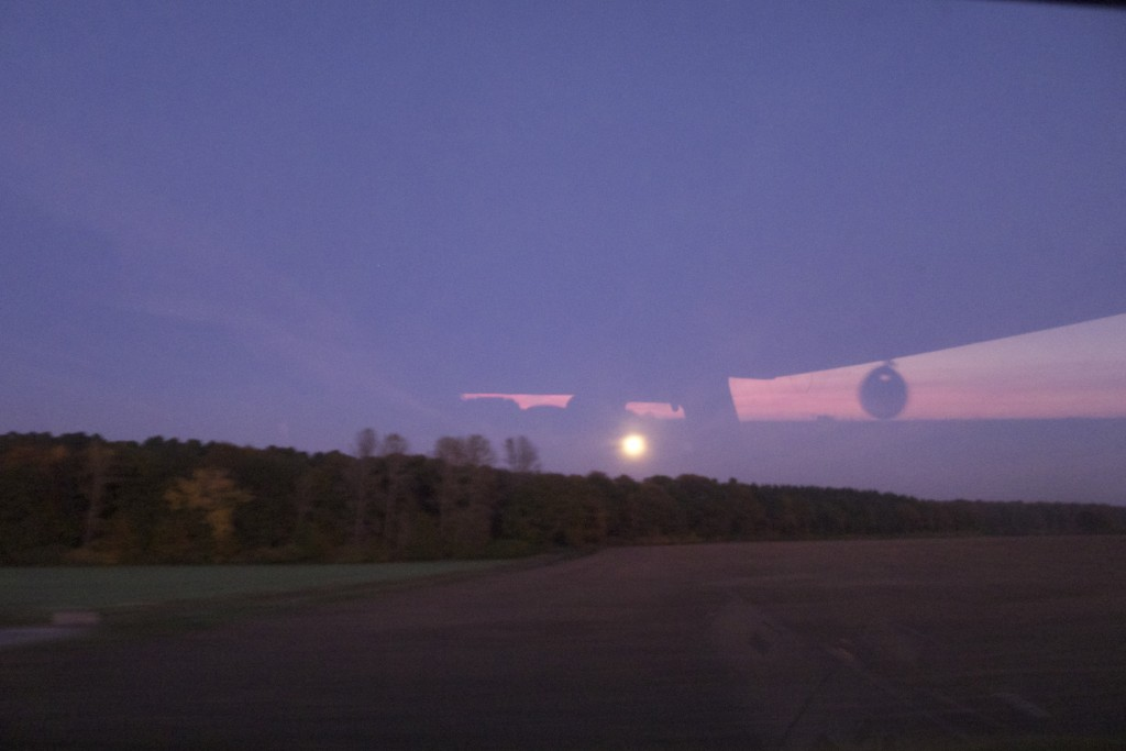 Full moon rising. Photo taken from inside the drivers cabin. the window's reflection of the sunset behind us can be seen in the sky above the moon.